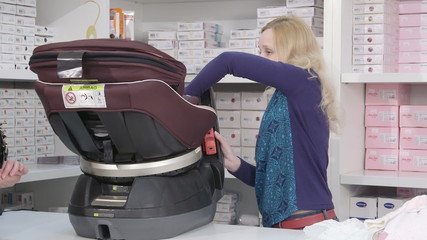 Buying baby convertible car seat in the shop