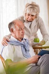 Senior woman caring about husband