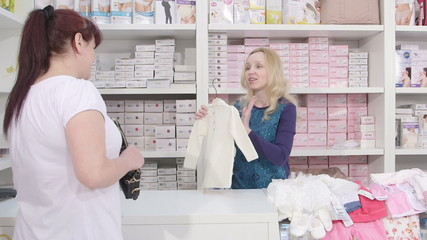 Baby clothes shopping in pregnancy and maternity shop