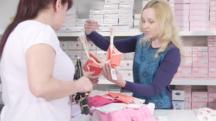 Buying clothes for pregnant  nursing mothers in baby   shop
