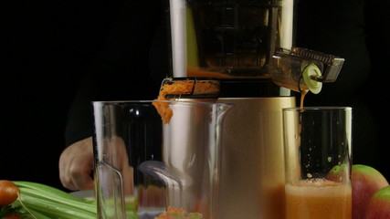 Process of extracting fresh juice from carrot apple and celery
