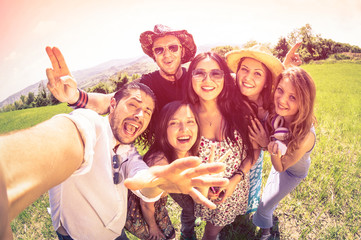 Best happy friends taking selfie at countryside picnic