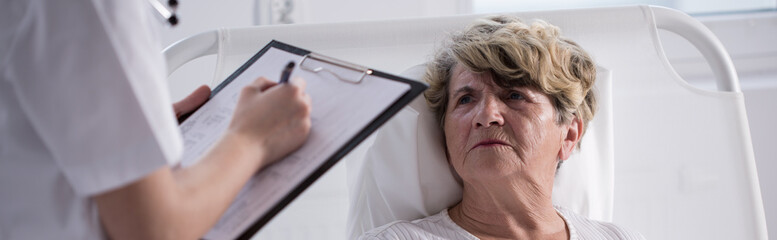 Unhappy woman staying in hospital