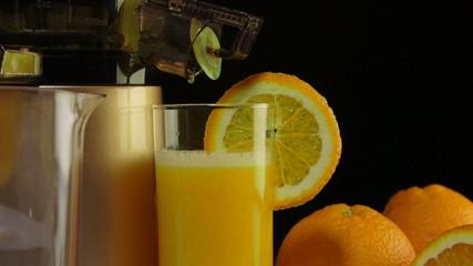 Glass  freshly squeezed fruit juice orange masticating juicer