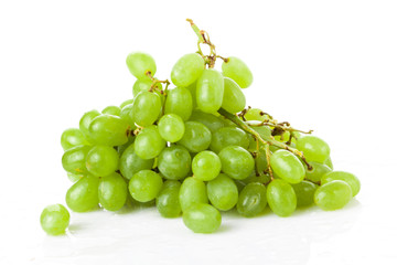 Fresh green grapes on white background
