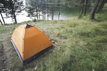 Tent in front of mountain dam