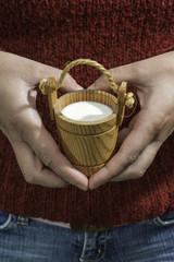 Vintage small wooden mug of milk