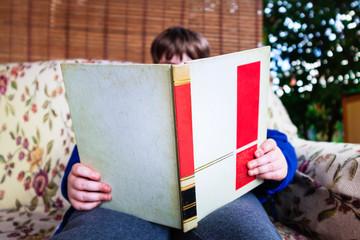 Child reader in the garden