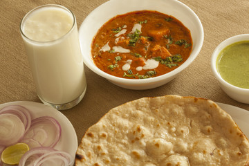 Paneer butter masala with tandoori roti and sweet lassi