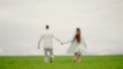 couple held hands and running