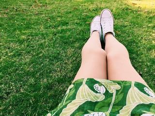 legs on green grass