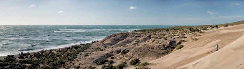 sand dunes and ocean patagonia landscape in valdes peninsula