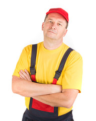 Worker in hat with crossed arms.