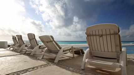 Caribbean beach with sunbathing beds