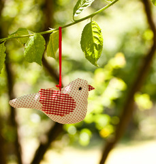 fabric bird hanging on a tree