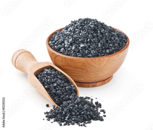 Leinwandbild Motiv Hawaiian black volcanic salt in a wooden bowl