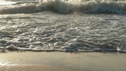 Sea wave at dawn the sun