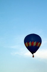 mostly blue hot air balloon flying in sky