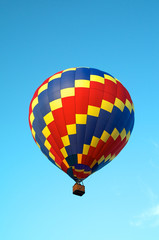 tricolored hot air balloon flying in sky