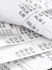 cash register receipts on the pile