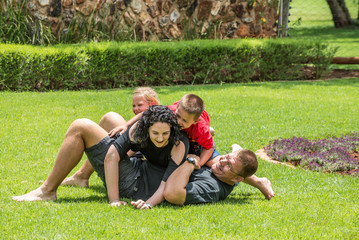 Family Playing on Lawn