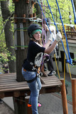 Girl climbing the rope
