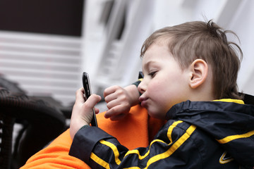 Kid playing with smartphone