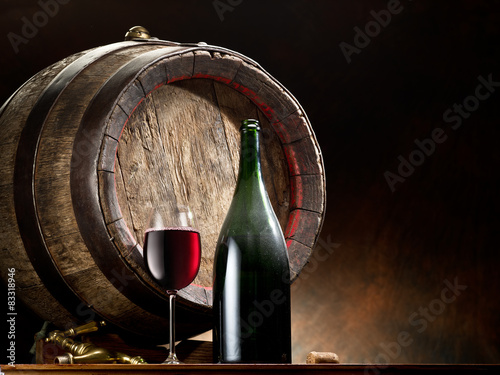 Still-life with glass of wine, bottle and barrel. © volff