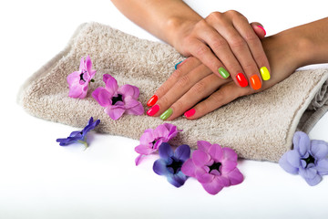 Woman hands with bright manicure on the towel