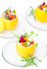 isolated stuffed lemons with vegetarian salad
