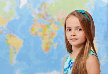 Young girl in front of world map