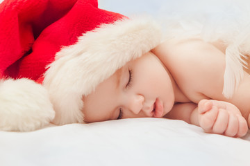 Small boy sleeping in a New Year's cap