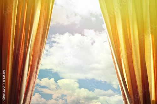 Plakat Window curtains with view of clouds and sky