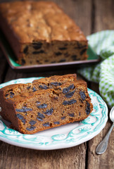 Cake with prunes and almond flour on a wooden table