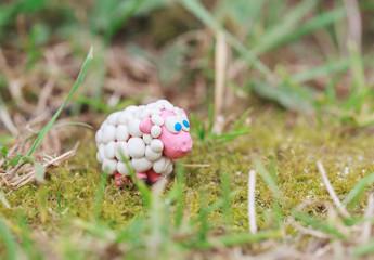 Plasticine world - little homemade white sheep with blue eyes