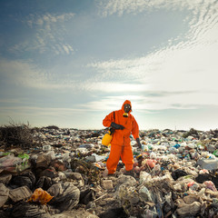 Recycling worker measuring pollution on the landfill