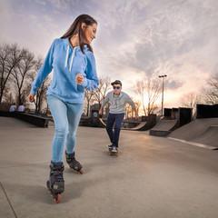 Teenage girl rollerblading in a skatepark