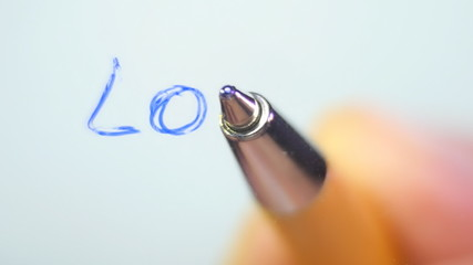 Writing the word LOVE on a transparent surface, a bottom view