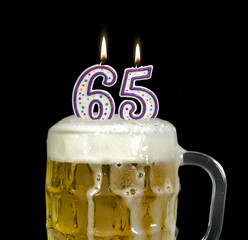 65th birthday candles in beer