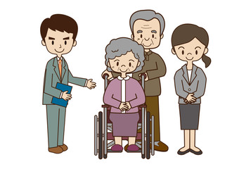高齢者夫婦と福祉スタッフ