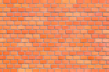 Red brick stone wall seamless background and texture