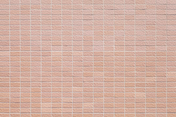 Red brick stone wall seamless background and texture.
