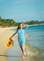 Happy woman enjoying beach relaxing joyful in summer by tropical
