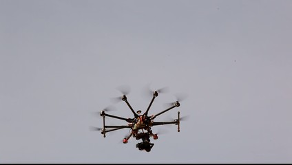 Aerial drone quadracopter with an action camera