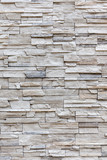 Fototapety Exterior grey brick wall, background wall pattern.