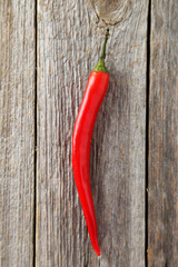 Red chili pepper on grey wooden background