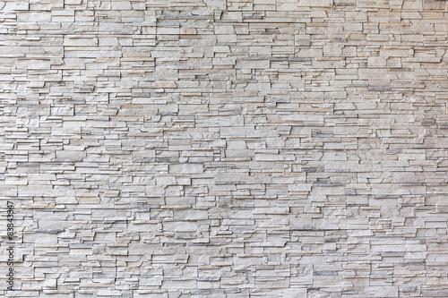Fototapeta The exterior granite brick wall building.