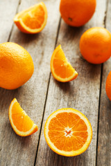 Fresh orange fruit on grey wooden background