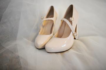 bride shoes on a veil
