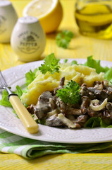 Beef liver stewed with mushrooms and onion in a sour cream.